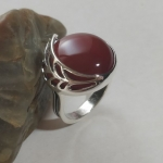 Silver ring round with a ponytail large dark carneol