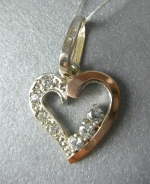 Silver pendant with gold applique