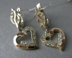 Silver earrings with gold applique
