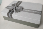 Middle rectangular white gray gift box